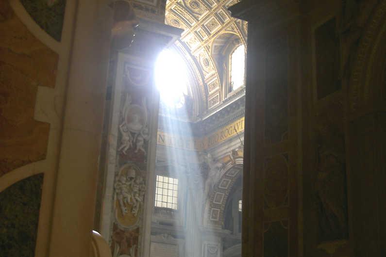 Sunlight shining through a window in St. Peter's Basilica