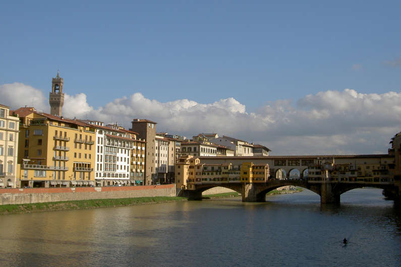 Someone Rowing Against the Current Under the Ponte Vecchio in Florence
