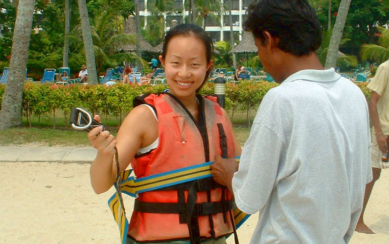 Nadia Getting Strapped into my Lifevest and Harness to Parasail