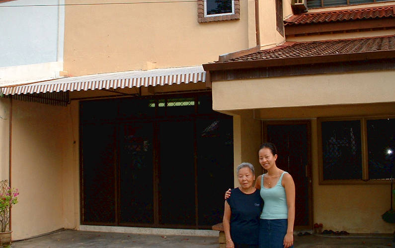 Nadia and Her Grandma Outside Their Family Home in Penang