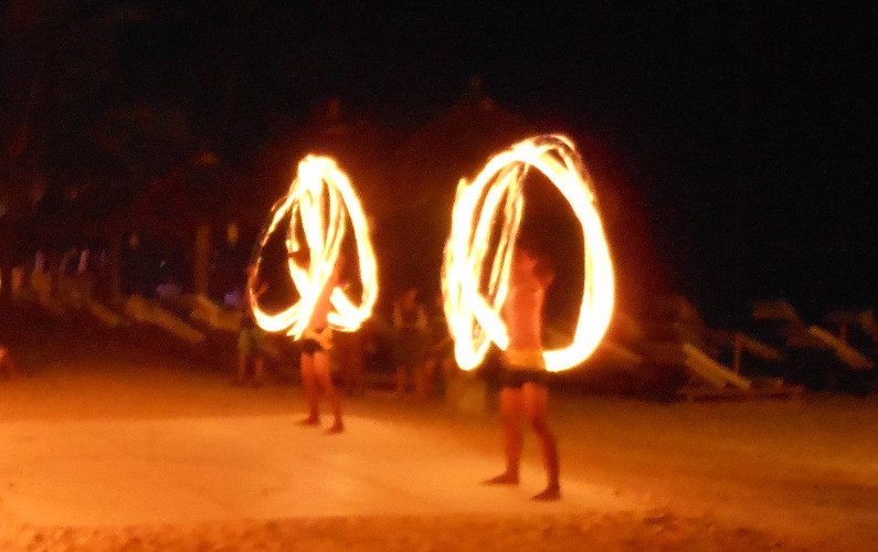 2 Boracay Fire Dancers Performing at night on the beach