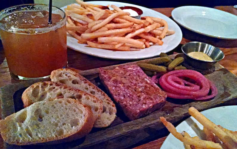 Clyde Common's Cold Cuts Dish of Meat and Bread with Fries and a Cocktail