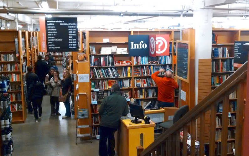 People Shopping Near the Info Desk at Powell's Bookstore