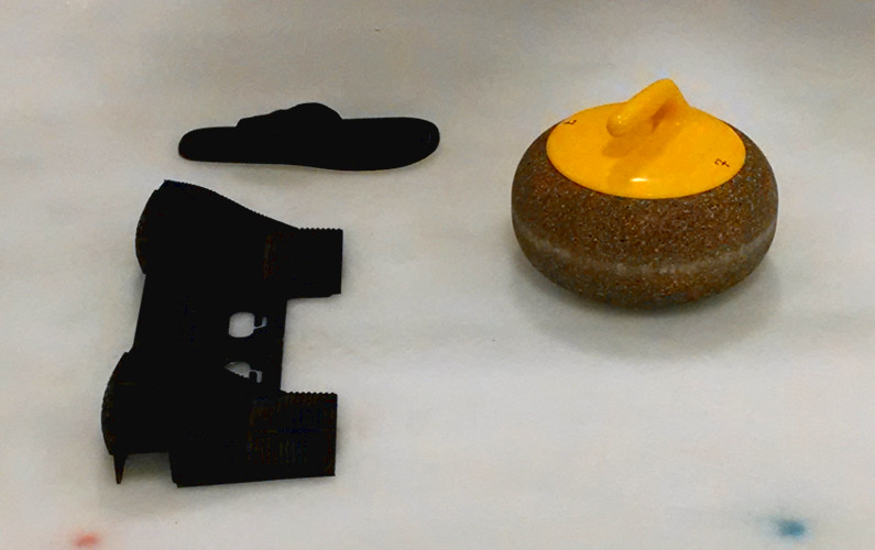 Close Up of the Curling Stone and the Curling Push Off with Curling Shoe Slip On
