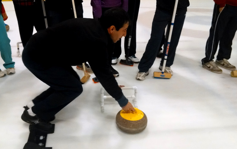 Instructor Demonstrating How to Curl Properly