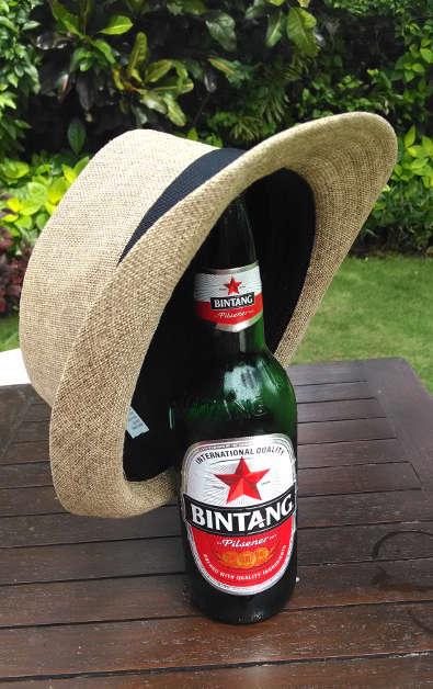 Nadia's Hat on Top of Her Bintang Beer Bottle at Villa Blubambu