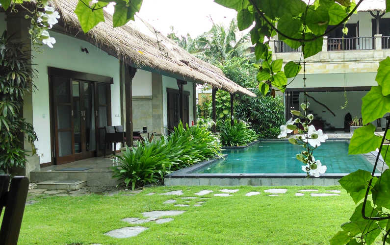One of the Pools and 2 of the Suites at Villa Blubambu