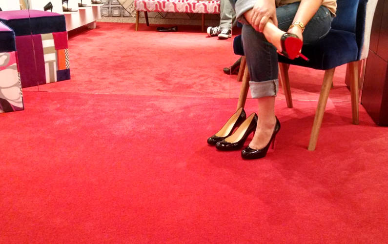 Nadia Reluctantly Removing the Pair of Christian Louboutin Pumps She Was Trying On