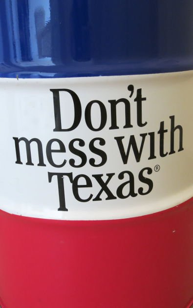 """A Can in the Red White Blue Colors of Texas with a Message That Says """"Don't Mess with Texas"""""""
