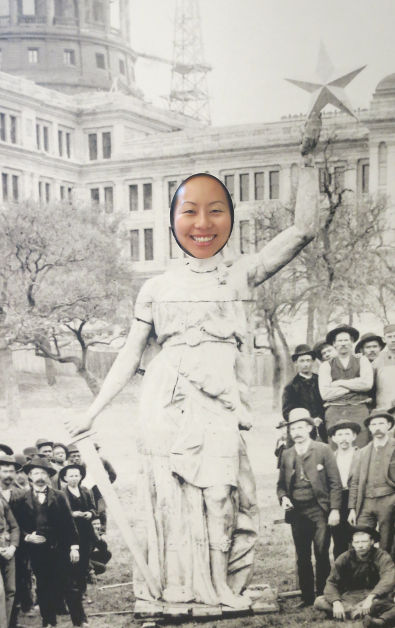 Nadia Posing in a Statue Cutout at the Texas Capitol