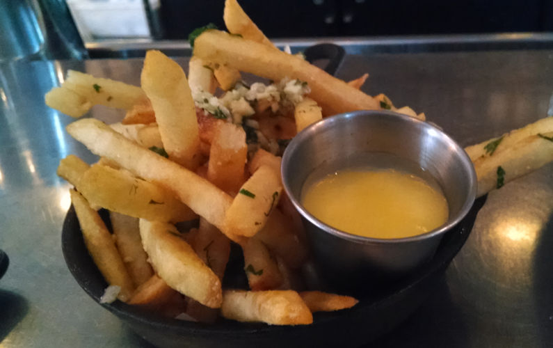 Parkside's Garlic French Fries with a Container of Dipping Sauce