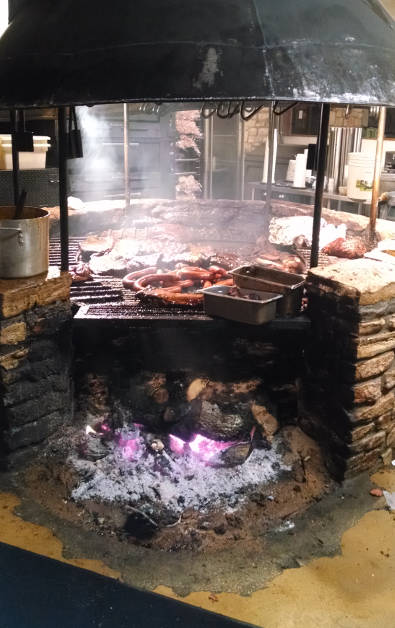 Salt Lick BBQ Grill Being Used to Cook Various Meats