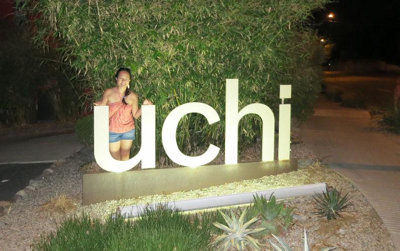 Nadia at the Uchi Sign