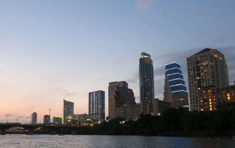 View of the Lit Up Austin City Skyline from the Lone Star Riverboat Tour