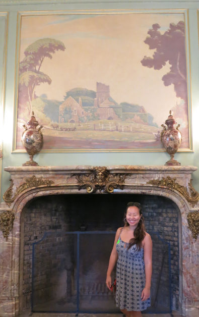 Nadia in Front of a Large Fireplace and Overhead Painting at Filoli