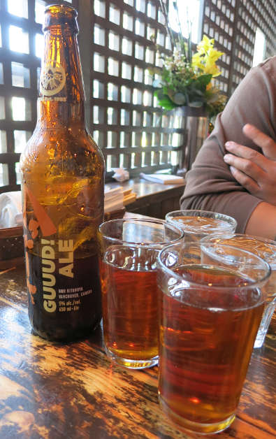 Guu with Garlic Bottle of Their Very Own Ale and 2 Glasses of Beer