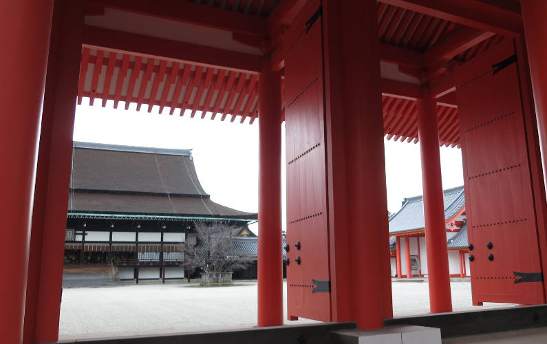 View of the Ceremonial Shishin-den Building Through the Red Jomeimon Gate at the Kyoto Imperial Palace