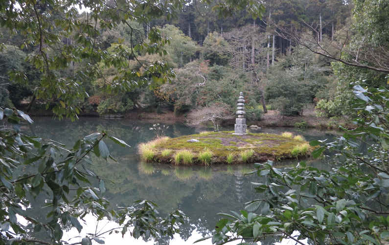 A Stone Pillar on a Small Island in a Pond at the Kyoto Golden Pavilion