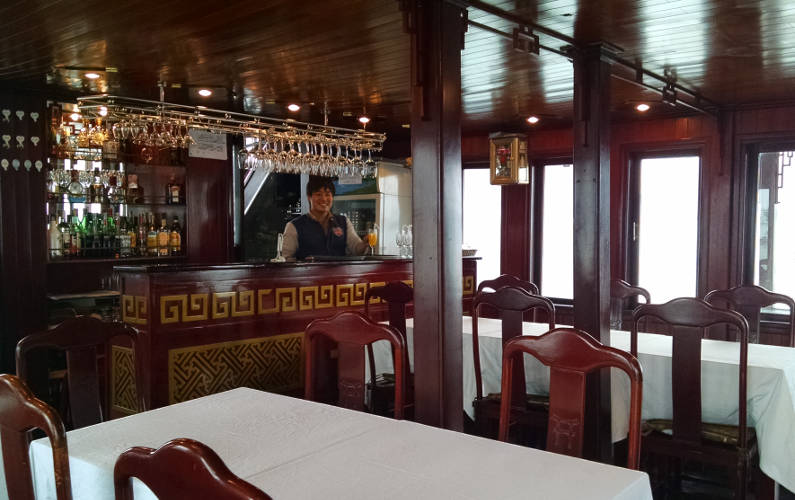 Interior Dining and the Bar and Bartender of the Indochina Junk