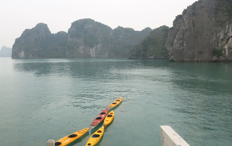 String of Kayaks Trailing Behind the Indochina Junk