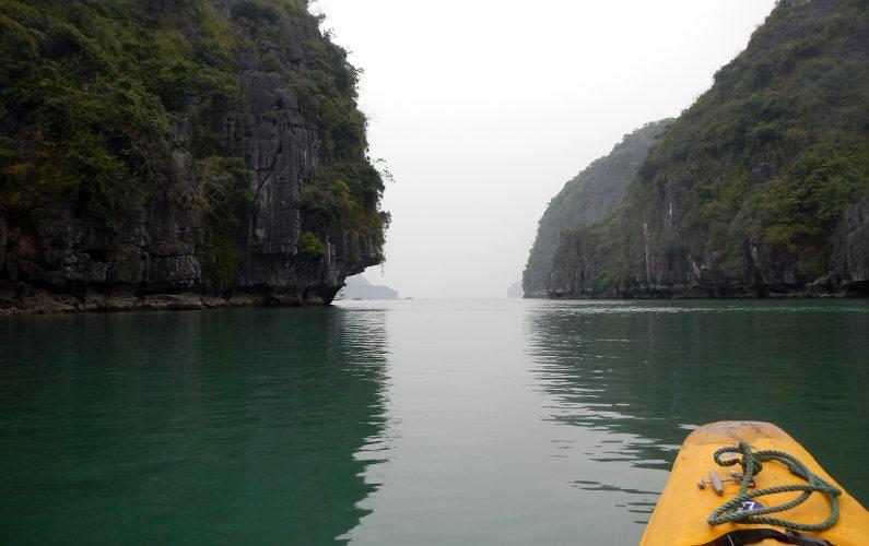 Solo Kayaking Toward Rocks During Indochina Junk Tour