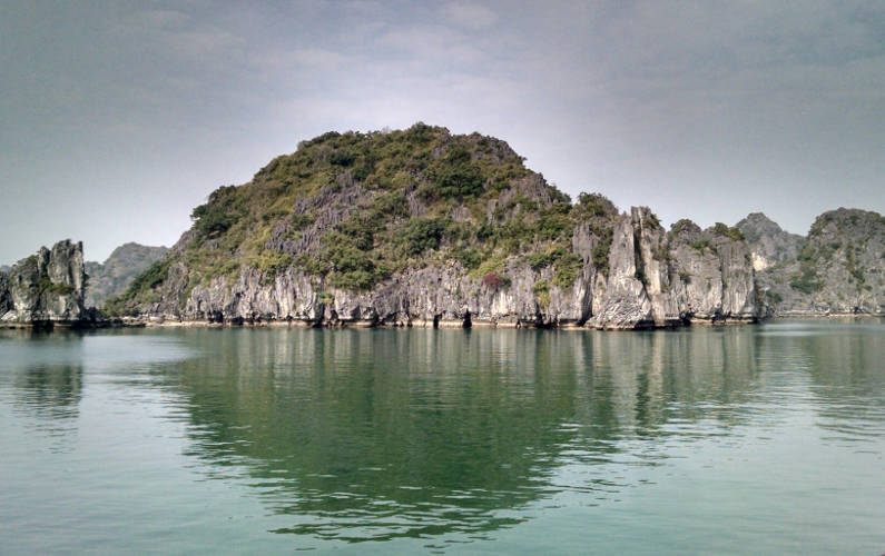 One of Many Islands in Bai Tu Long Bay During the Indochina Junk Tour