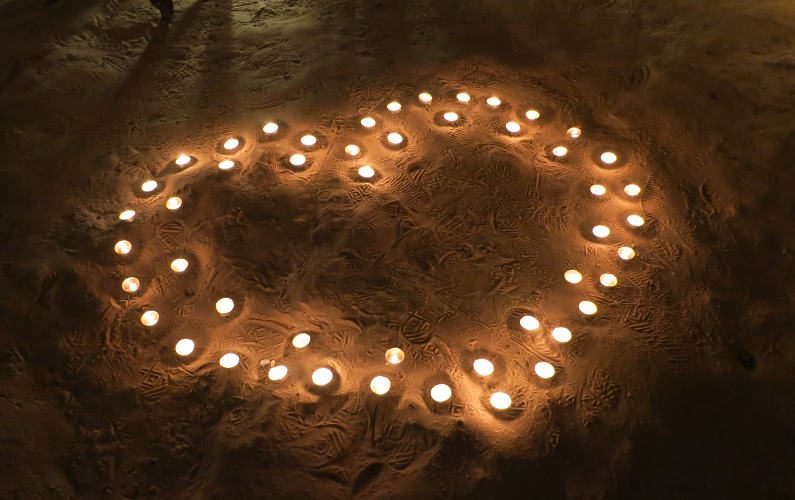 Heart Outline Made Up From Lit Candles at Indochina Junk Cave Dinner