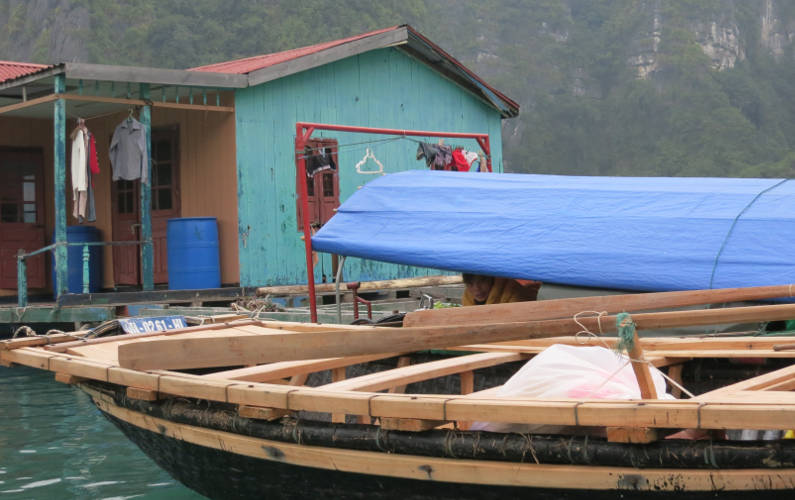 Fishing Villager in Their Floating Homes at the End of the Indochina Junk Tour