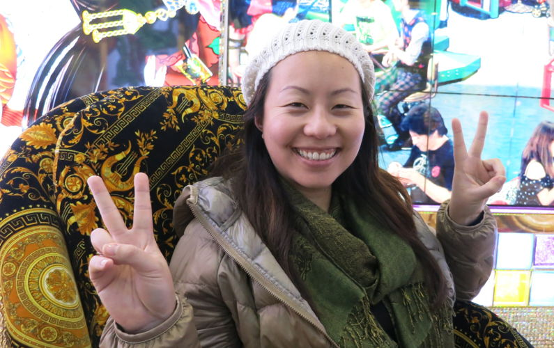 Nadia with 2 Peace Signs at the Robot Show