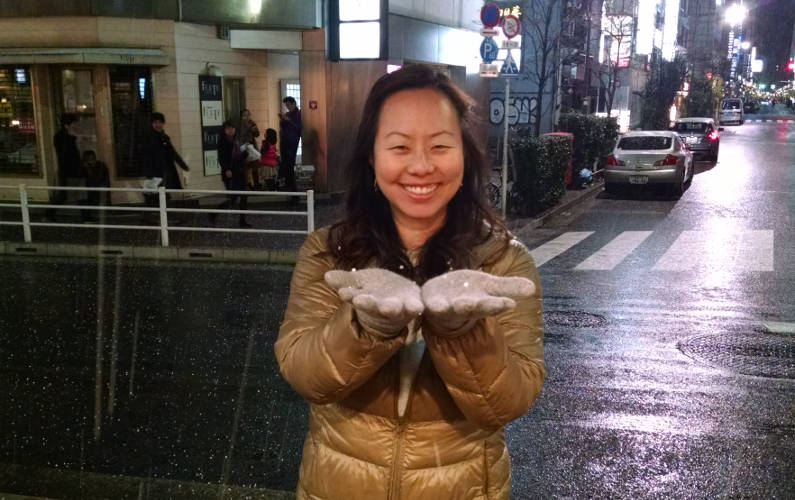 Nadia Catching Snow Outside While in Line for Midori Ginza