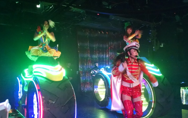 Robot Show Female Costumed Drummers on Wheeled Vehicles and Solo Performing for the Audience