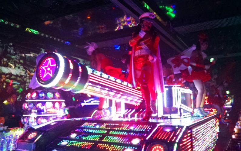 Robot Show Dancer on a Neon Lit Tank