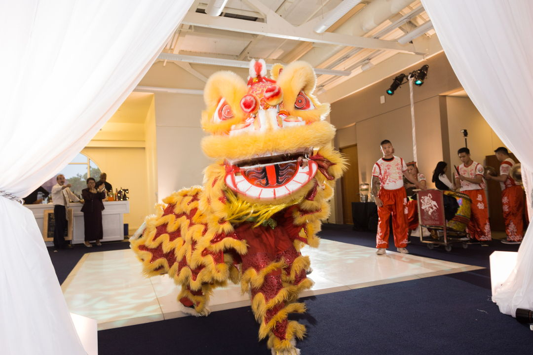 Chinese Lion dancers entering the room