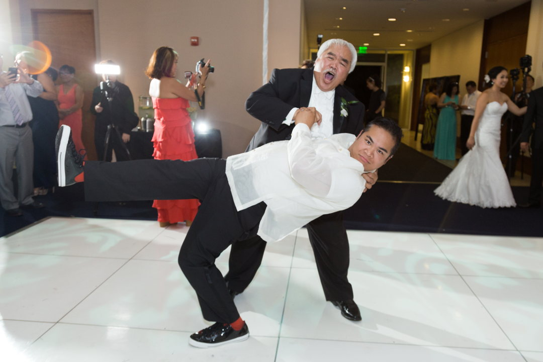JM being dipped by his father on the dance floor