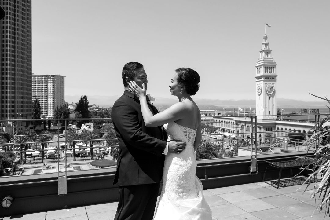Nadia and JM holding each other in front of SF ferry building