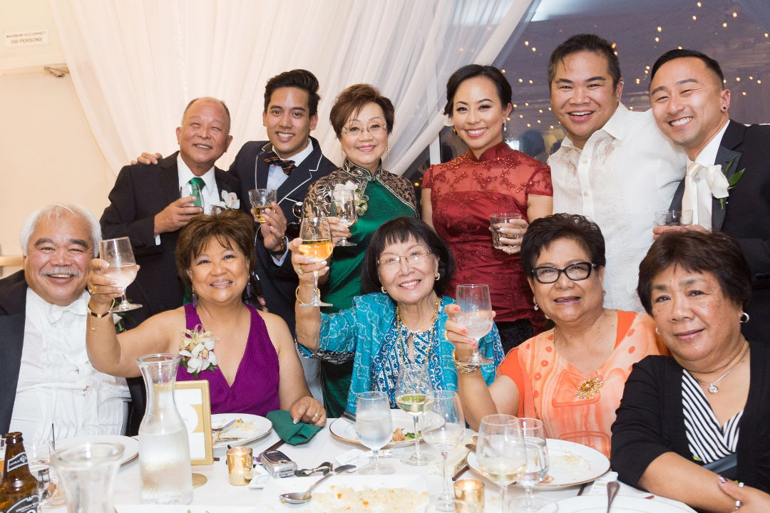 Nadia and JM toasting with table guests 10