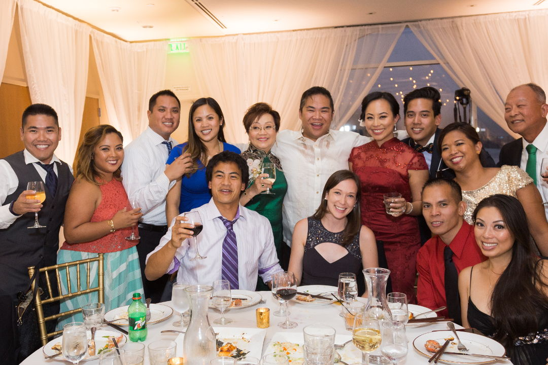 Nadia and JM toasting with table guests 12