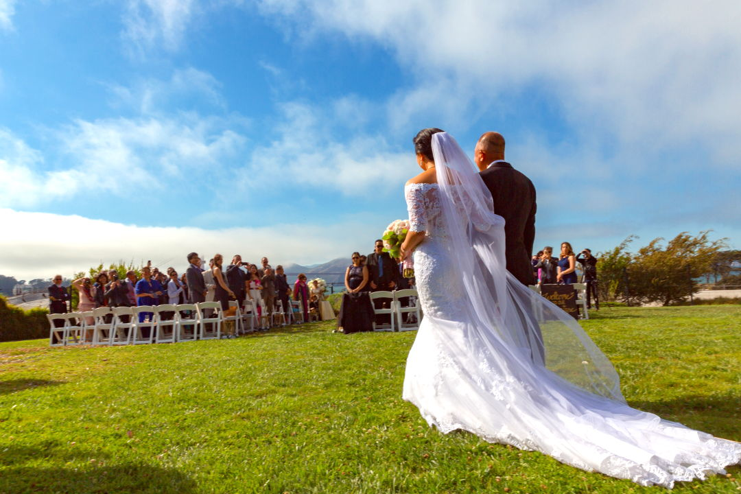 Nadia being walked down the aisle by her father at SF Presidio