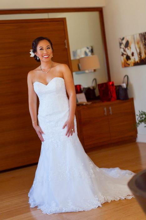 Nadia posing in her white wedding dress before the wedding