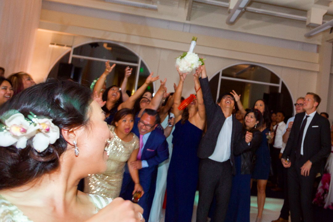 Nadia tossing the boquet into the crowd