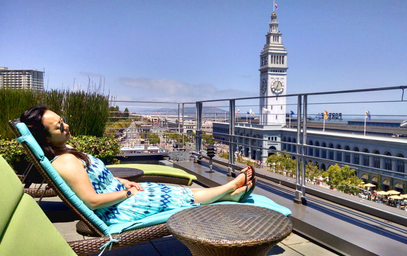 Nadia on a Lounge Chair Taking in the Sun at the Hotel Vitale with a View of the Ferry Building