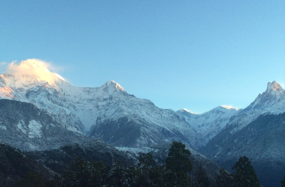 Sun Lighting Up the Snowing Annapurna Peak in Ghandruk Nepal