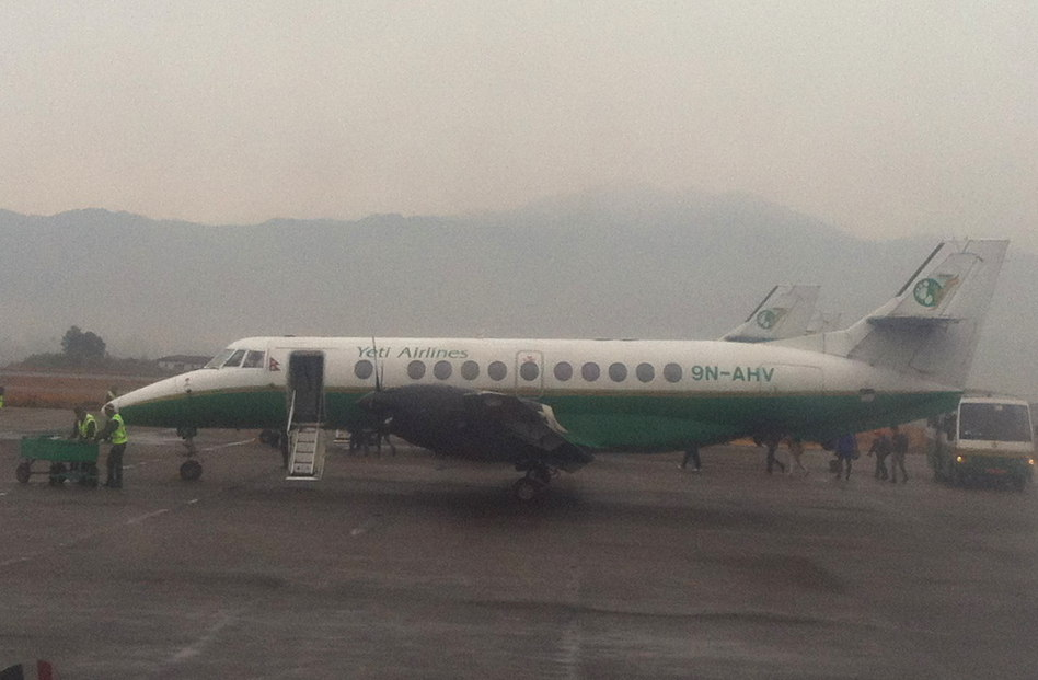 Foggy Take Off in a Yeti Airlines Twin Engine Prop Plane