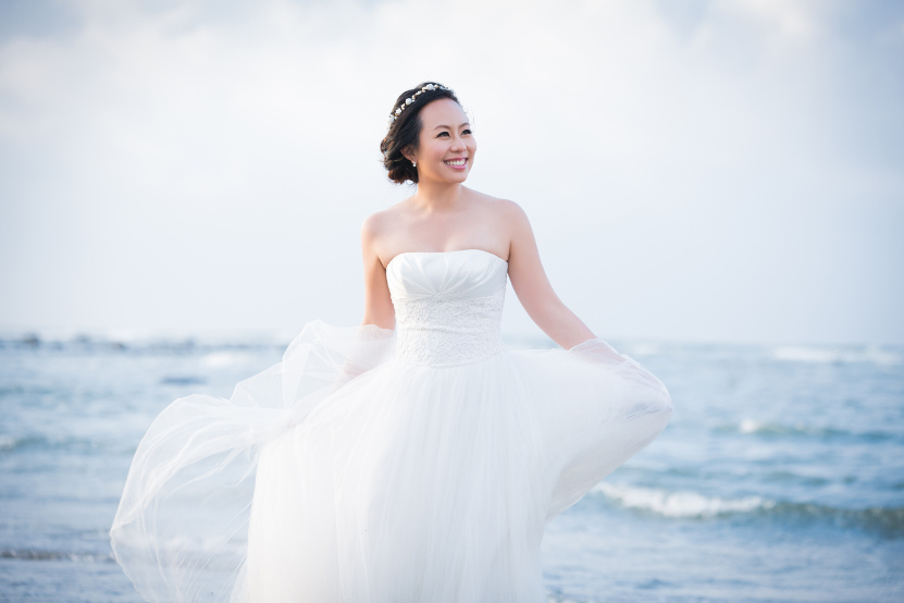 Barefoot Nadia in a White Wedding Dress on the Beach by Ching Hua Bridal Art
