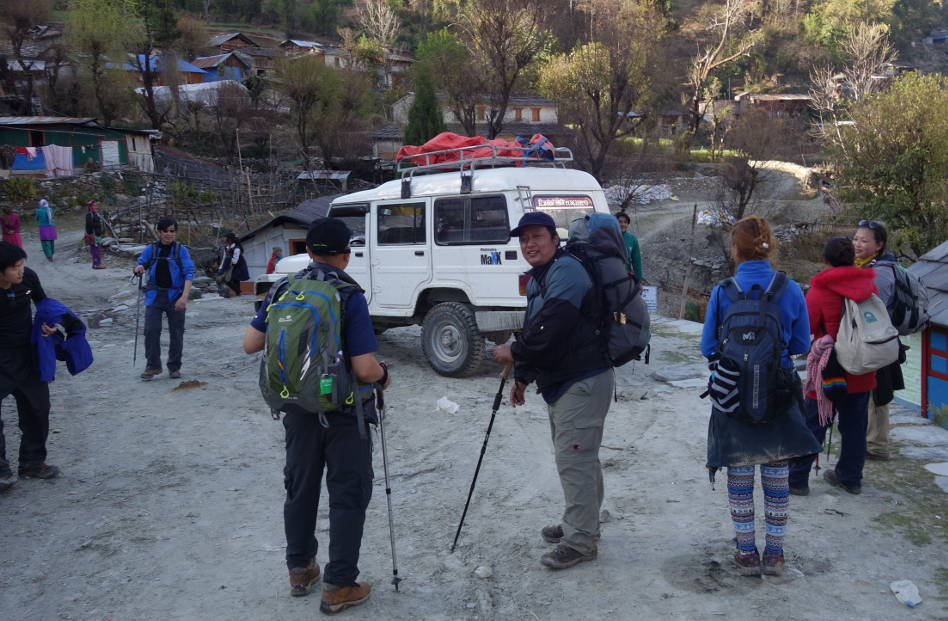 Hikers Near a White SUV in Poon Hill Nepal