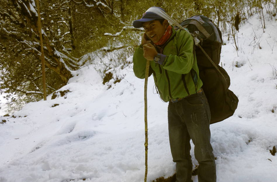 A Happy Nepalese Porting Some of the Luggage Through the Snow in Ghandruk Nepal