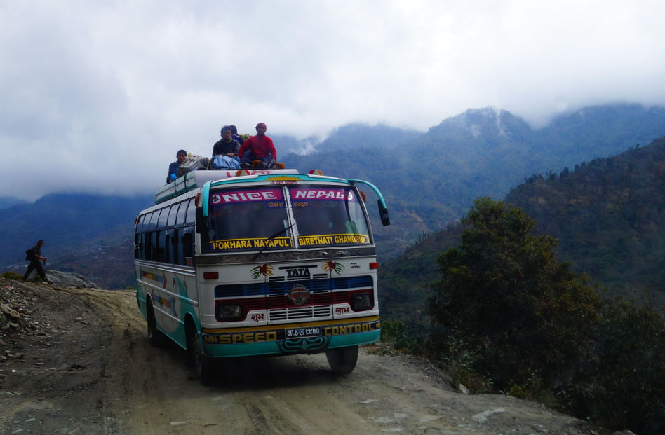 Local Transportation with People on Top of the Bus in Nepal