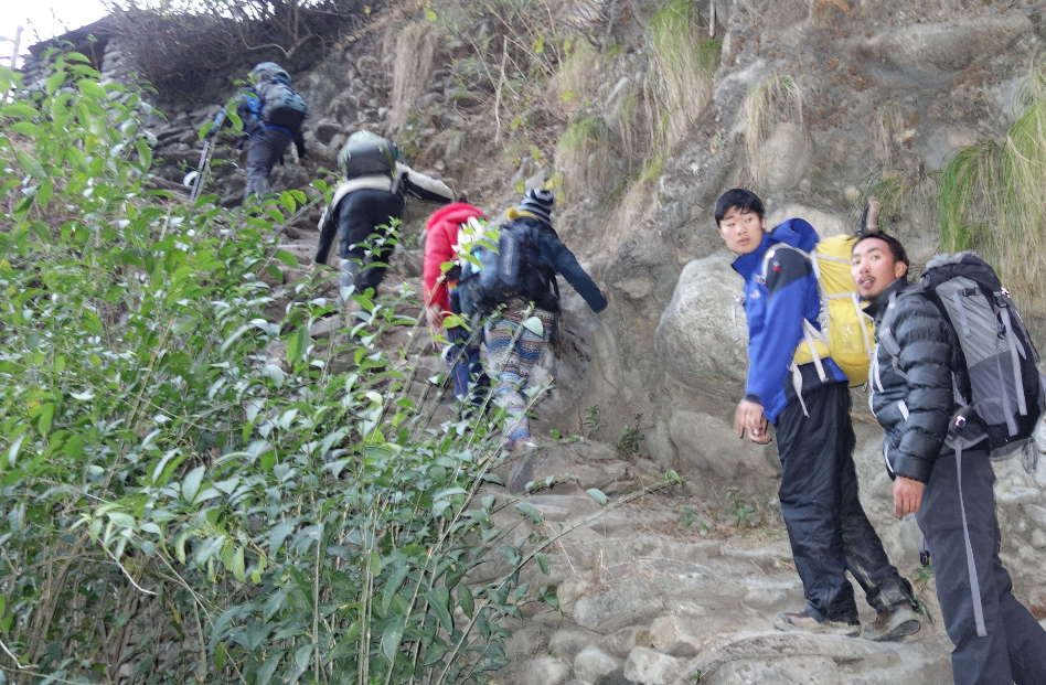 Hikers Going Up a Long Flight of Stairs to the Hotel in Nepal