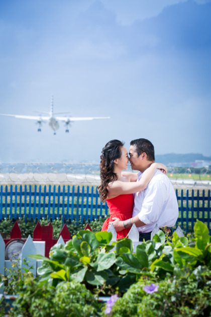 Nadia in a Red Dress About to Kiss JM with a Plane About to Land at Taipei Songshan Airport By Ching Hua