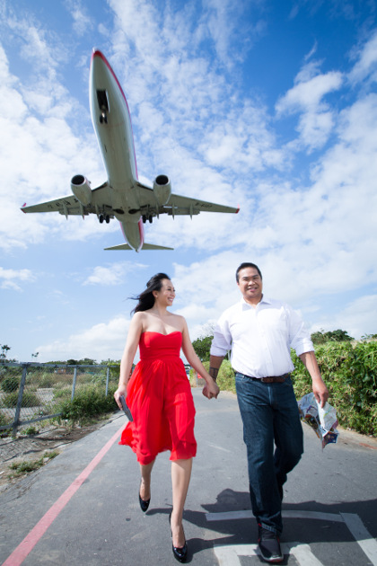 Nadia in a Red Dress and JM Below a Plane at Taipei Songshan Airport By Ching Hua